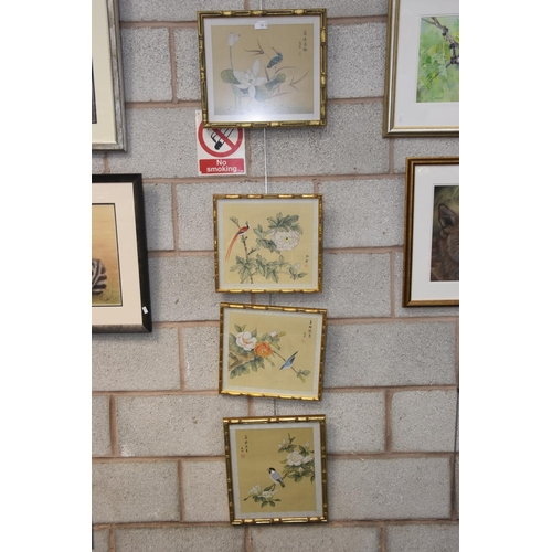 26 - Four various Chinese paintings on rice paper each depicting a bird perched on a flowering branch....
