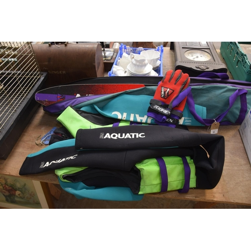 29 - A cased pair of Aquatic sport water skies and an Aquatic sport wet suit....