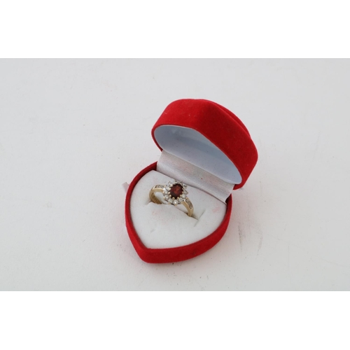 60 - 9ct and White Stone Ring with Central Red Stone - 3.1g...
