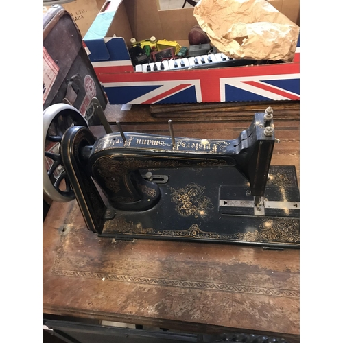 475 - Frister & Rossmann Sewing Machine and Table...
