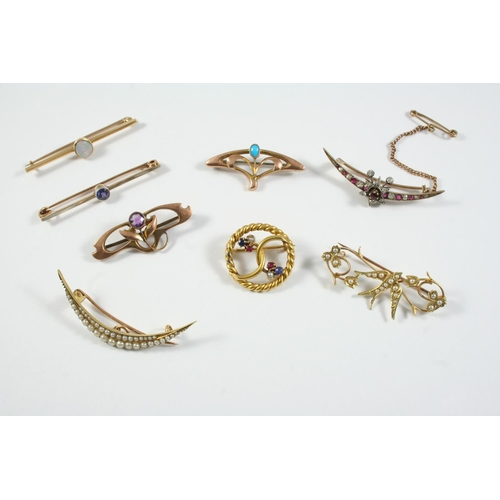 1669 - A QUANTITY OF ASSORTED BROOCHES including a ruby and diamond star and crescent brooch, set in gold, ...