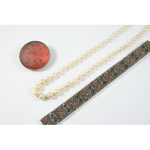 1671 - A CULTURED PEARL NECKLACE the pearls graduate from 3.6mm to 7.9mm to a  9ct white gold clasp, 49.5cm...
