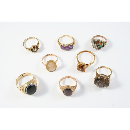 1679 - A GARNET AND HALF PEARL CLUSTER RING set in gold, size N 1/2, an amethyst three stone ring, set in y...