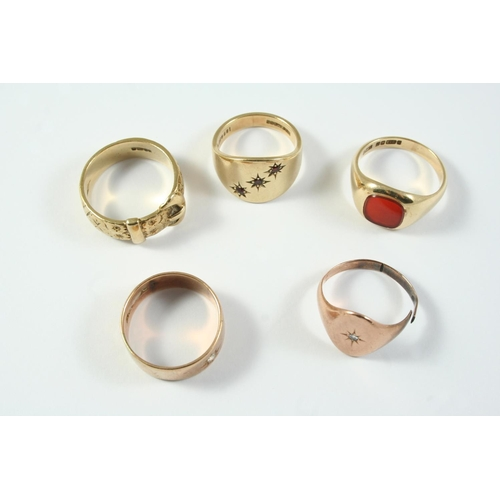 1686 - A 9CT GOLD BUCKLE RING with foliate engraved decoration, size V 1/2, a 9ct gold ring, set with a sma...