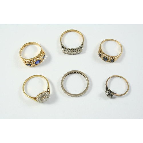 1692 - A SAPPHIRE AND DIAMOND RING the three graduated circular-cut sapphires are set with four diamond hig...