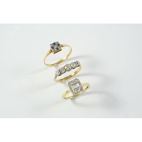 1696 - A DIAMOND CLUSTER RING centred with three baguette-cut diamonds within a border of single-cut and ba...