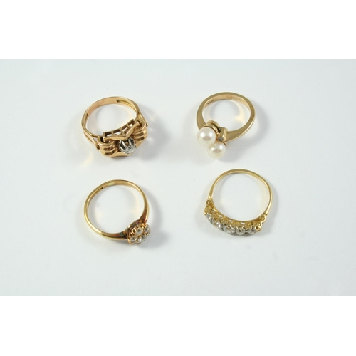 1697 - A DIAMOND FIVE STONE RING set with five graduated old cut diamonds in yellow gold carved mount, size...