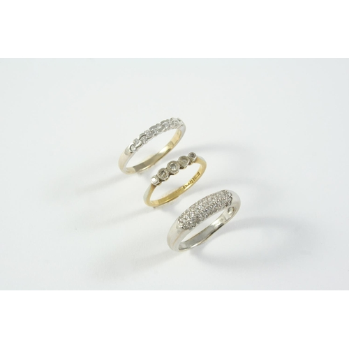 1698 - A DIAMOND HALF HOOP RING set with staggered circular-cut diamonds, in 18ct white gold, size R, toget...