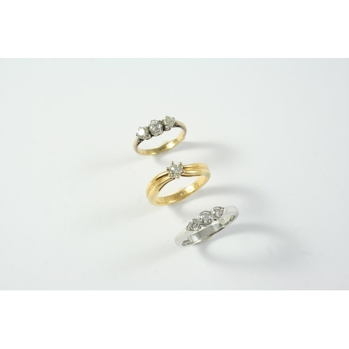 1701 - A DIAMOND SOLITAIRE RING set with a circular-cut diamond in yellow gold, size L 1/2, together with a...