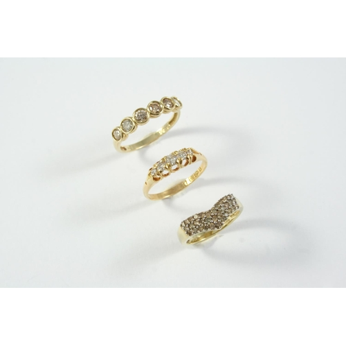 1702 - A DIAMOND FIVE STONE RING set with five graduated circular-cut diamonds, in 18ct gold, size O 1/2  ,...