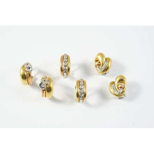 1708 - A PAIR OF DIAMOND AND 18CT GOLD HALF HOOP EARRINGS each earring set with a row of five collet diamon...