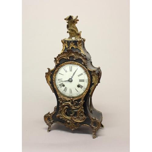 2123 - A LOUIS XV ORMOLU MOUNTED MANTLE CLOCK. An elaborate Louis XV style mantle clock, the white enamelle...