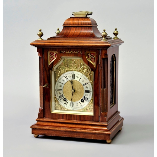2135 - A WALNUT AND BRASS MOUNTED MANTEL CLOCK, late 19th century, the brass dial with a 4 1/2