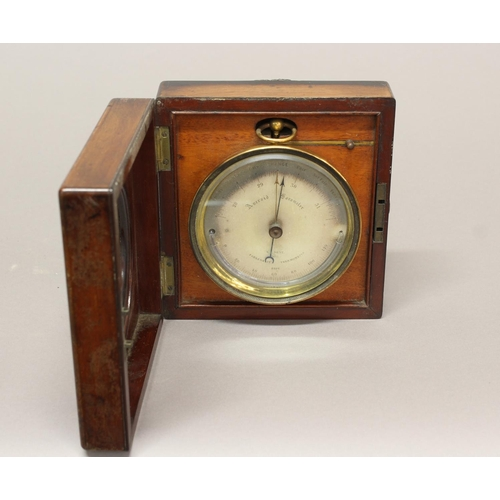 2148 - A VICTORIAN MAHOGANY CASED TRAVELLING BAROMETER BY DENT OF PARIS. A brass cased aneroid Barometer by...