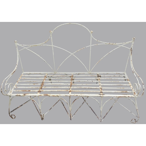 2171 - A MID 20TH CENTURY WROUGHT IRON GARDEN BENCH. The garden seat with a raised arched back above scroll...