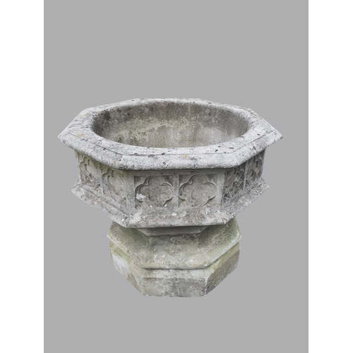 2172 - A LARGE GOTHIC REVIVAL COMPOSITION STONE GARDEN URN.  With a broad dished octagonal top with quatref...