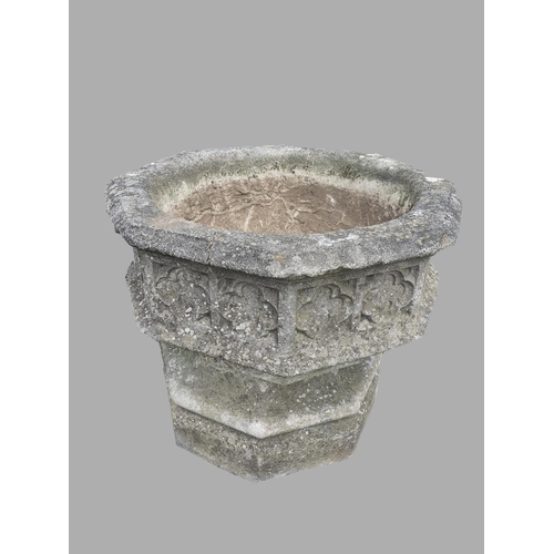 2173 - A LARGE GOTHIC REVIVAL COMPOSITION STONE GARDEN URN.  With a broad dished octagonal top with quatref...