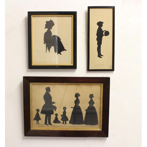 2179 - A VICTORIAN SILHOUETTE AND TWO OTHERS. A large silhouette portrait of a family, with three young chi...