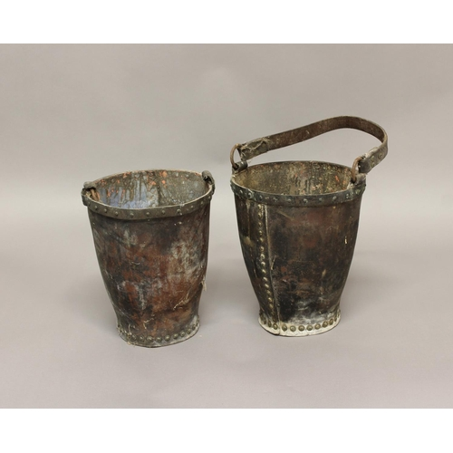 2183 - TWO SIMILAR LEATHER FIRE BUCKETS. Two fire buckets of riveted leather construction with metal rims a...