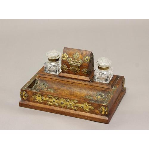 2185 - VICTORIAN BURR WALNUT AND GILT BRASS INKSTAND. A Victorian burr walnut desk stand with dished pen tr...