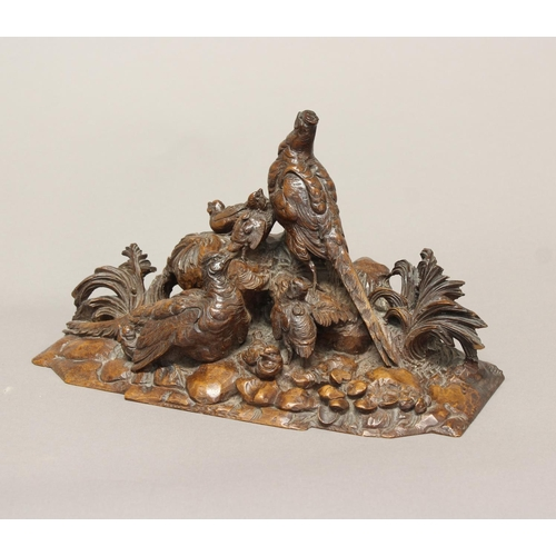 2187 - A VICTORIAN CARVED WALNUT SCULPTURE OF GAME BIRDS. A finely carved walnut group of two adult game bi...