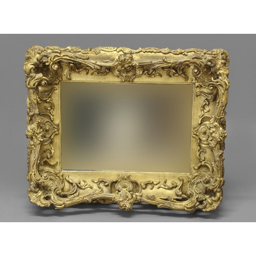 2198 - AN ELABORATE LATE 19TH CENTURY STYLE WALL MIRROR. An elaborate rectangular wall mirror with a bevell...
