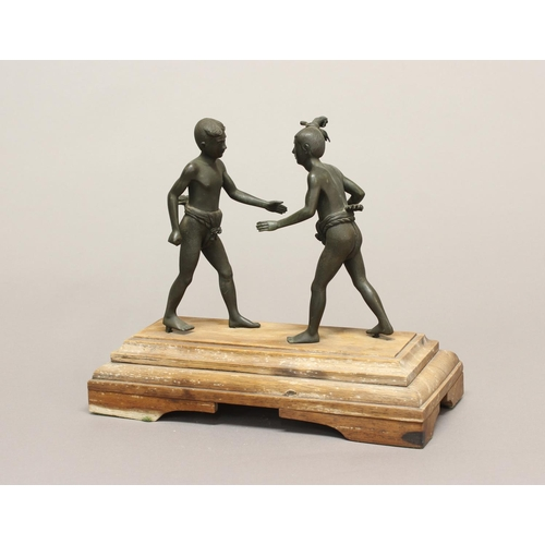 2199 - A LATE 19TH EARLY 20TH CENTURY BRONZE STUDY OF TWO WRESTLERS. A cast and patinated bronze study of t...