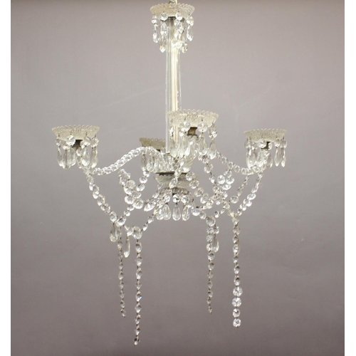 2206 - A FOUR BRANCH HANGING CHANDELIER. With an octagonal tapering clear glass column with cut sides and t...
