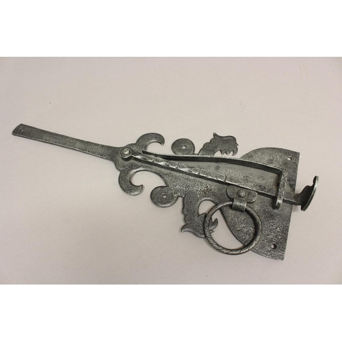 2221 - A 17TH CENTURY STEEL DOOR LATCH. An English 17th century steel door latch of elaborate scrolling out...