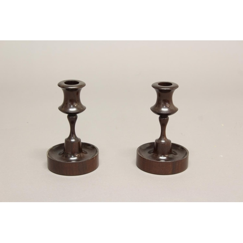 2226 - A PAIR OF VICTORIAN TURNED CANDLESTICKS. A finely turned pair of candlesticks with concave sided sco...