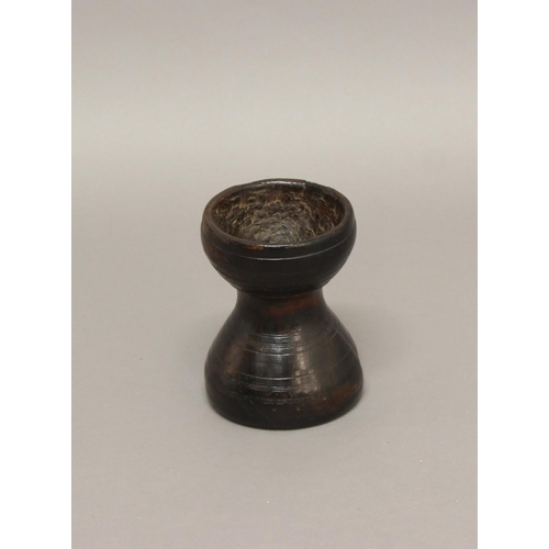 2227 - AN 18TH CENTURY TURNED TREEN MORTAR. A turned wooden mortar of waisted cylindrical form with ring de...