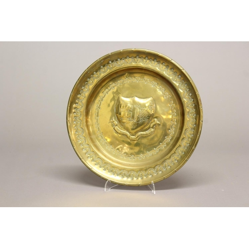 2228 - A 19TH CENTURY BRASS ALMS DISH. A brass alms dish, the centre decorated with the arms of Bristol wit...