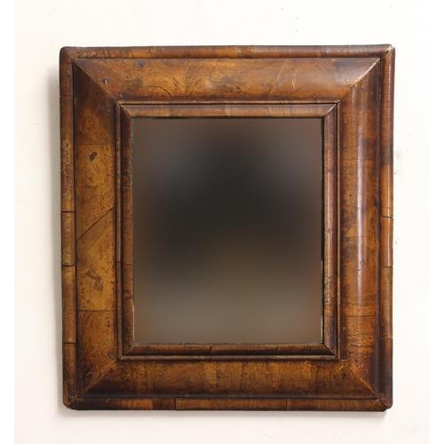 2249 - AN 18TH CENTURY WALNUT CUSHION MIRROR, the rectangular plate inside a moulded frame, 50cm x 45cm