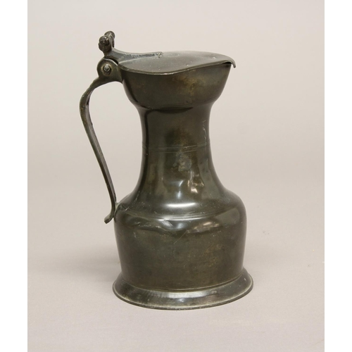 2254 - A 19TH CENTURY CONTINENTAL PEWTER FLAGON. A pewter flagon with flat topped lid, waisted body and cir...