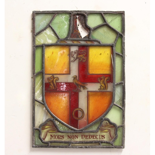 2260A - A STAINED GLASS ARMORIAL PANEL, with a shield shaped armorial featuring a lion passant, two squirrel...