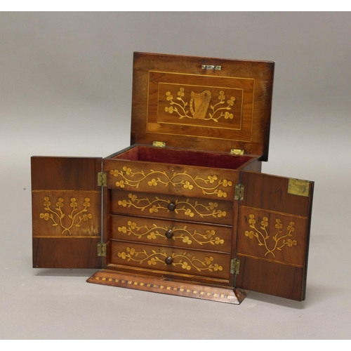 2262 - A KILLARNEY WARE TABLE CABINET. The cabinet with twin doors beneath a rising stepped top, the interi...