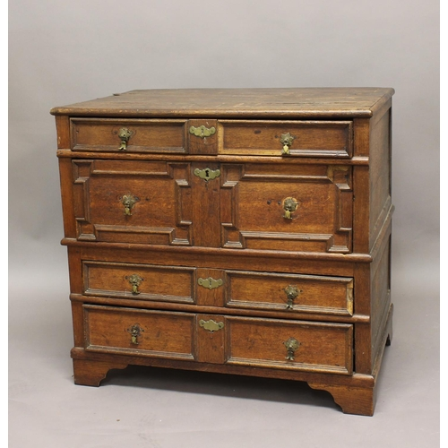 2276 - AN OAK CHEST OF DRAWERS, late 17th/early 18th century, with four panelled long drawers on bracket fe...
