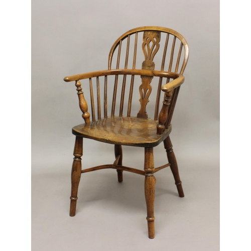 2278 - A YEW AND ELM WINDSOR ARMCHAIR, 19th century, the arched back above a pierced, vase shaped splat, on...