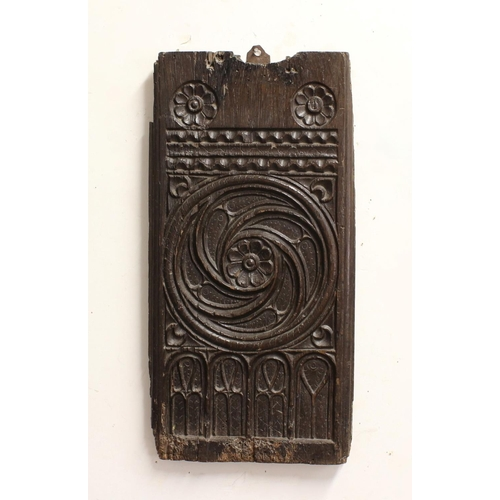 2283 - A 16TH CENTURY PEW END SECTION. A rectangular section from a 16th century or earlier pew end, carved...