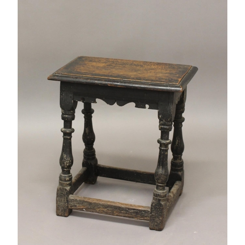 2294 - A CHARLES II STYLE OAK JOINT STOOL. A joint stool with a rectangular seat with moulded edge above a ...