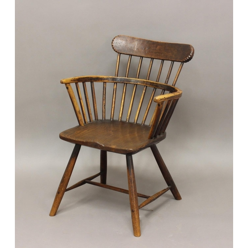 2299 - A PRIMITIVE LOW-BACKED WINDSOR ARMCHAIR. A primitive country made low-backed beech and elm Windsor c...