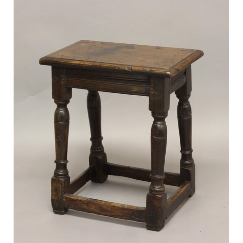 2301 - A 17TH CENTURY OAK JOINT STOOL, the rectangular top on turned legs and box stretcher, height 55cm, w...