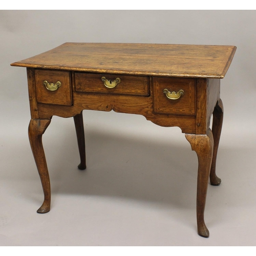 2302 - AN 18TH CENTURY OAK LOWBOY, the rectangular top above three inlaid drawers, on cabriole legs, height...
