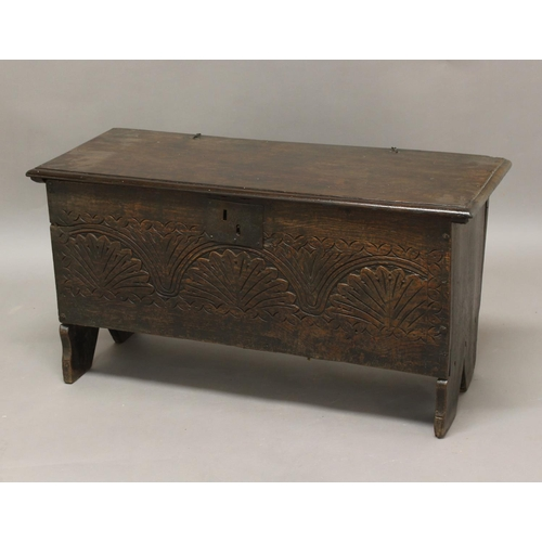 2306 - A 17TH CENTURY OAK PLANK COFFER, the front with arched and foliate carving, height 51cm, width 99cm,...