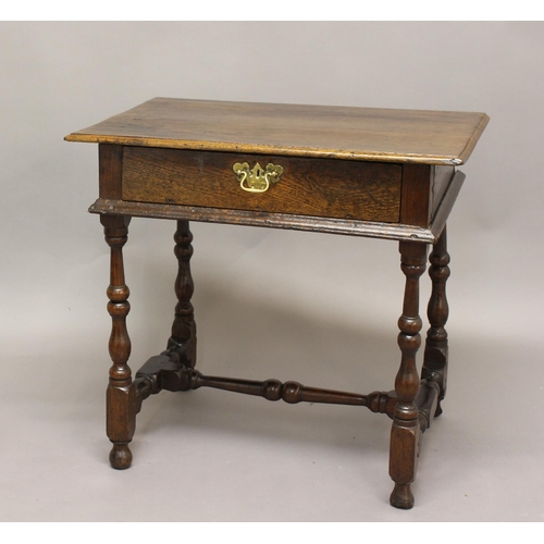 2307 - A 17TH CENTURY OAK SIDE TABLE, the rectangular top above single drawer on turned and block supports,...