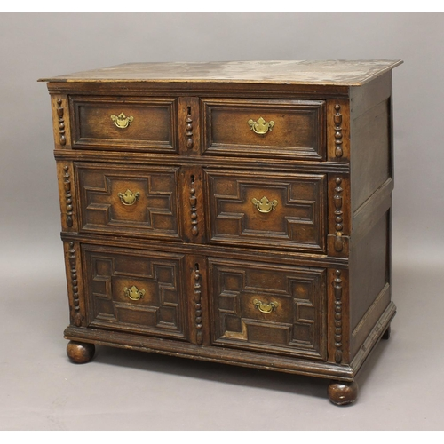 2309 - AN OAK CHEST OF DRAWERS, 17th century and later, with three graduated long drawers on bun feet, in t...