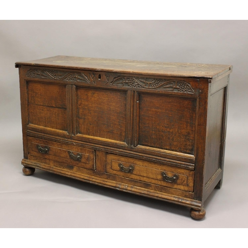 2311 - AN OAK MULE CHEST, 18th century and later, the carved frieze initialled 'M.Y' above panelled front a...