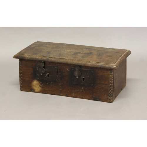 2312 - A 17TH CENTURY OAK LOCKBOX, with twin iron locks and chip carved detailing, height 22cm, width 60cm,...