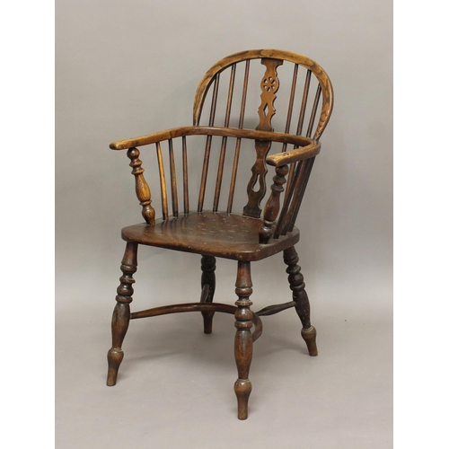2313 - AN ASH AND ELM WINDSOR CHAIR, the arched spindle back with wheel splat, turned supports and crinolin...