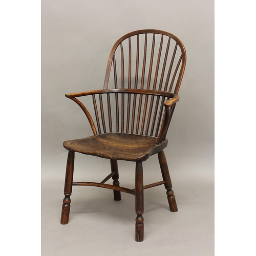 2315 - A YEW AND ELM WINDSOR CHAIR, the comb back above solid seat, turned legs and crinoline stretcher, he...